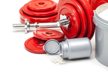 Body building - dumbbells and dietary supplements photo