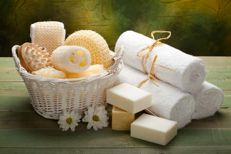 Spa - white towels, soap and massage accessory photo