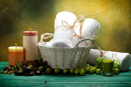 Bath salt, towels and candles - spa supplies photo