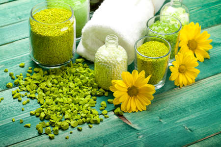 Yellow flowers and green bath salt photo