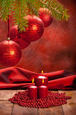 Christmas decoration - red baubles and candles photo