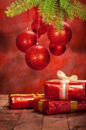 Christmas background - decoration red balls and gifts photo