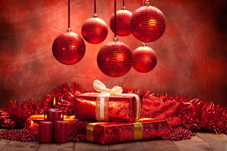 Christmas background - balls, candles and gifts Stock Photo