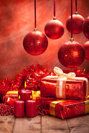 Christmas decoration - gifts, balls and candles photo
