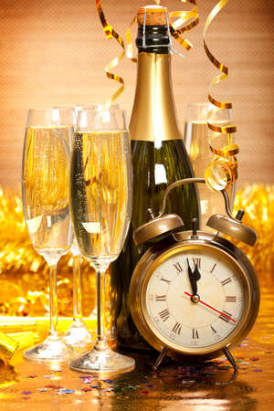 Happy New Year - Champagne and clock Stock Photo