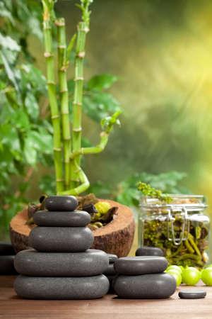 Spa treatment - hot stones on bamboo background Stock Photo - 10582744