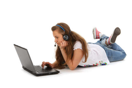 Teen with laptop on white background photo