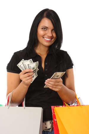 Young woman with money and shopping bags photo