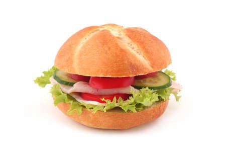 Ham, tomato, cucumber and salad sandwich isolated on white background photo