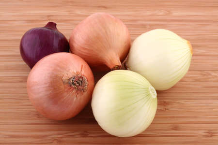 Onions on kitchen board