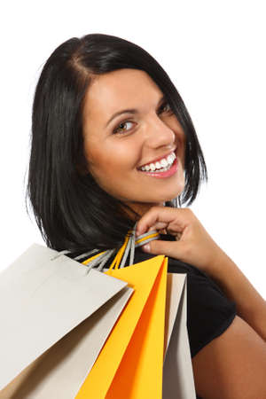 Smiling woman with shopping bags photo
