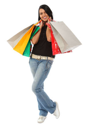 Smiling young woman with shopping bags photo
