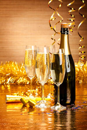 Happy New Year - champagne and party decoration Stock Photo