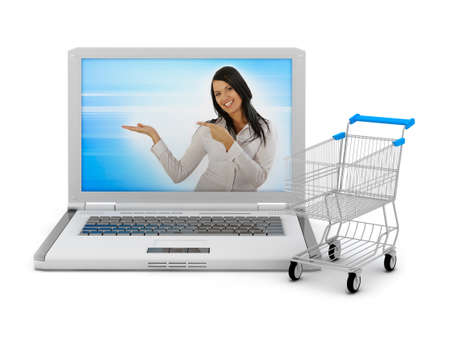 Internet shopping - laptop and shopping cart photo