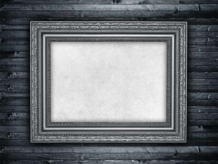 Paper sheet in picture frame on wood background photo