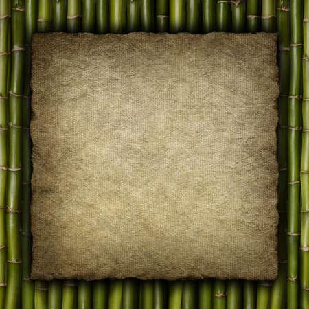 Handmade paper sheet on bamboo background photo