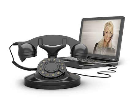 Retro telephone and laptop photo