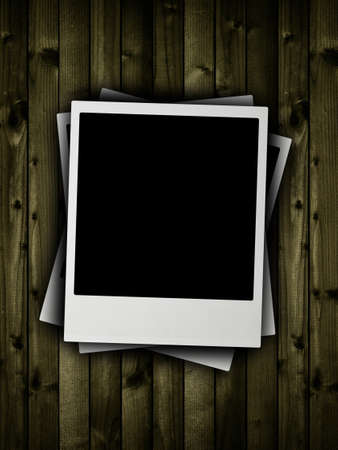 Blank pictures on plank background Stock Photo