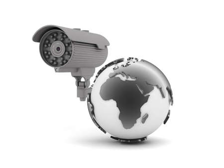 Security camera and earth globe on white background photo