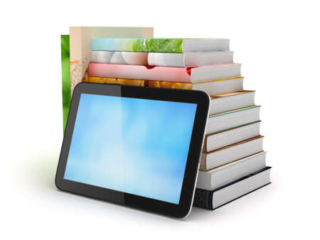 Tablet computer and stack of books photo