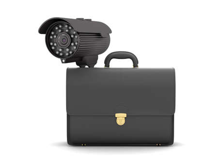 Surveillance video camera and business briefcase photo
