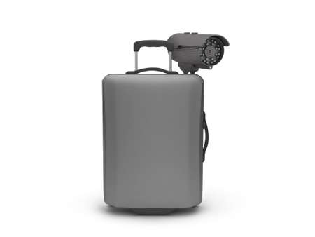 Video surveillance camera and travel bag on white background