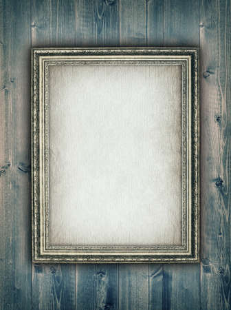 Picture frame on wooden background photo