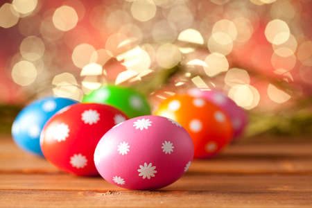 Colored Easter eggs on wooden planks photo