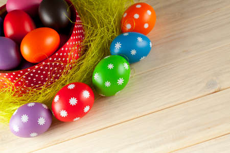 Colored Easter eggs on wooden background photo