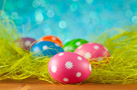 Colored Easter eggs on blue background photo