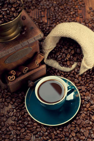 winnower: Cup of coffee, coffee beans and old grinder Stock Photo
