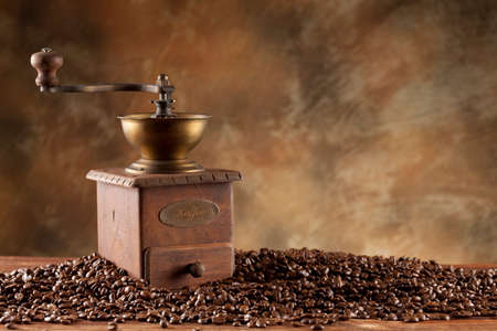 winnower: Coffee grains and old coffee grinder Stock Photo