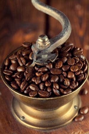 winnower: Coffee grains in old coffee grinder Stock Photo