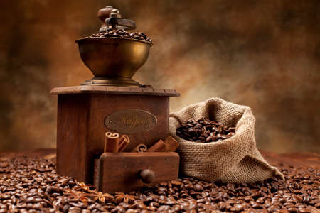 Coffee beans and old grinder photo