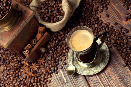 winnower: Coffee cup and beans, old coffee grinder and canvas sack Stock Photo