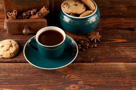 winnower: Coffee cup, cookies and old coffee grinder