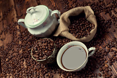 winnower: Coffee cup, beans and canvas sack Stock Photo