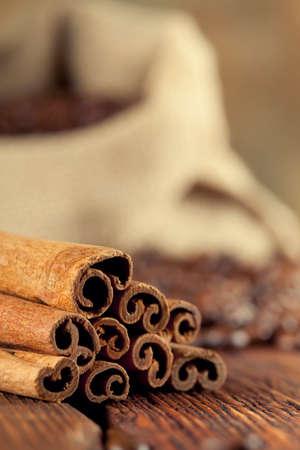 winnower: Cinnamon sticks, coffee grains and old grinder Stock Photo