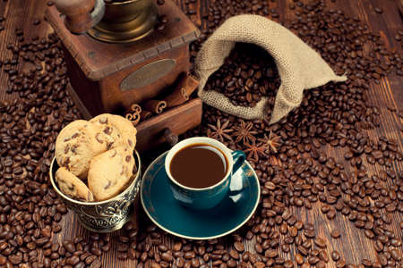 winnower: Coffee cup and beans, old grinder and jute sack Stock Photo