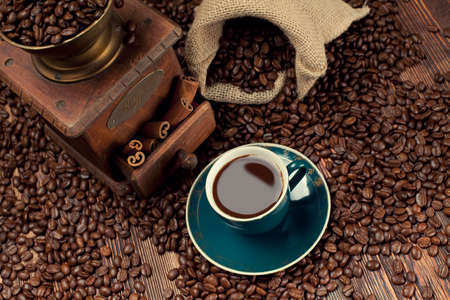 winnower: Coffee cup, beans and old grinder