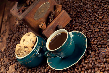 winnower: Coffee cup and coffee grains on old planks
