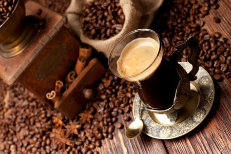 winnower: Cup of coffee and coffee grains Stock Photo