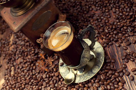 winnower: Coffee cup and beans, old coffee grinder