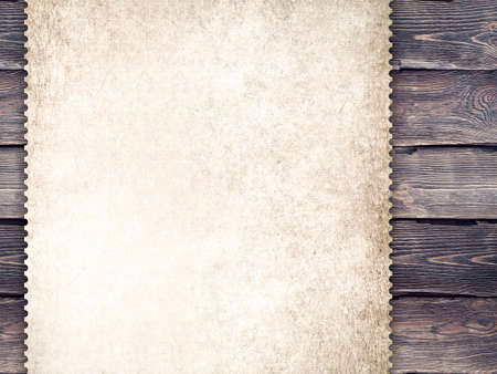 Handmade paper sheet on old wood plank wall background