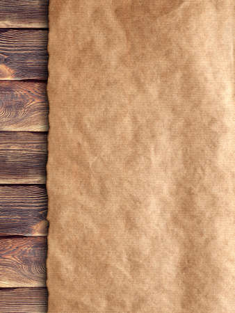 board: Creased handmade paper on wooden wall background Stock Photo
