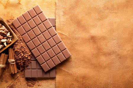 sweetmeats: Chocolate bars and ingredints od chocolate on paper background