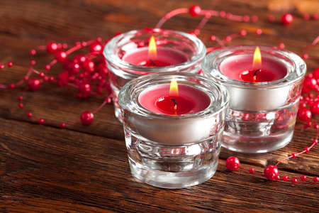 goody: Christmas candles on wooden planks background