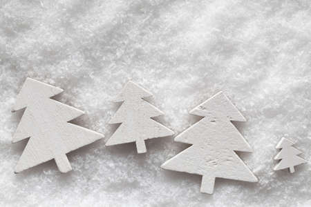 goody: Wooden Christmas trees on snow