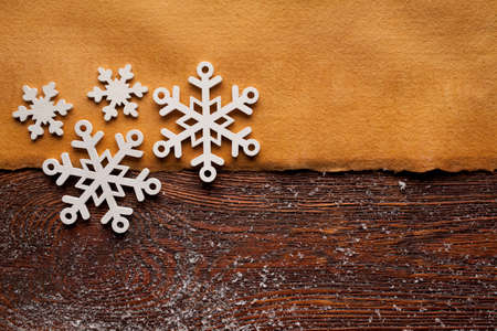 goody: Christmas background - blank handmade paper sheet and snowflakes Stock Photo
