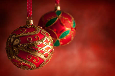 goody: Christmas baubles on red background